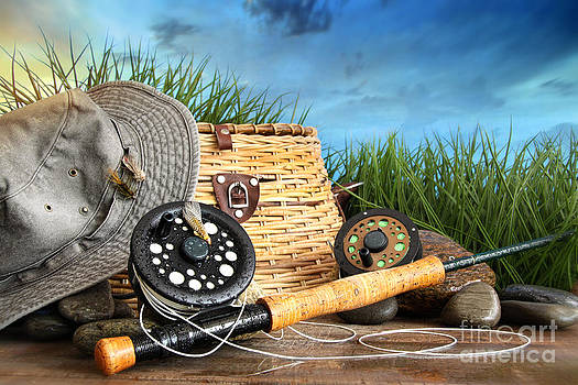 Sandra Cunningham - Fly fishing equipment with hat on wooden dock