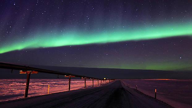 Northern Lights Over Oil Pipeline by Wyatt Rivard