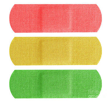 Red yellow and green bandaids by Blink Images