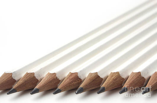 Row of white pencils by Blink Images