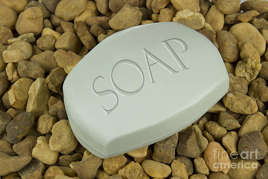 Soap Bar on stones background by Blink Images