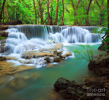 Waterfall in the forest  by Noppakun Wiropart