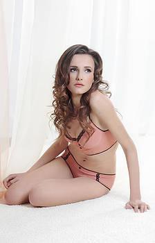 Young woman in underwear by Iryna Shpulak