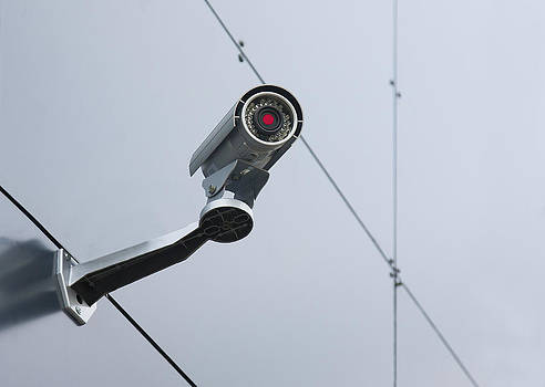 A Security Camera Mounted On The Wall by Jaak Nilson