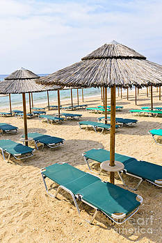 Elena Elisseeva - Beach umbrellas on sandy seashore