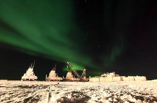 Northern Lights Over Dry Docked Boats by Wyatt Rivard