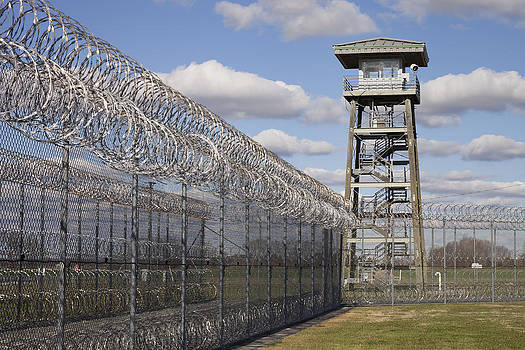 Prison Fence Watch Tower And Barbed by Roberto Westbrook