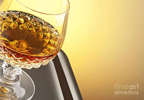 Whiskey in stem glass by Blink Images