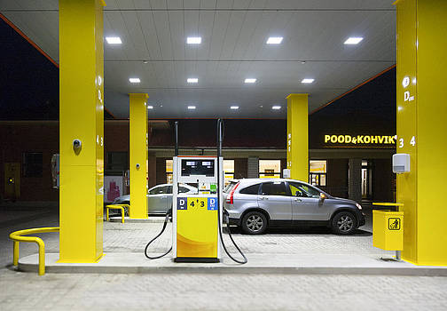 A Roadside Garage At Night.  Yellow by Jaak Nilson