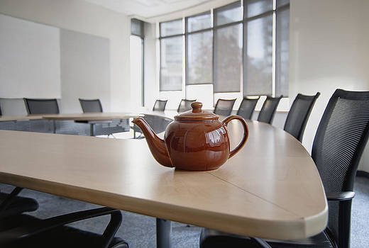 A Brown China Teapot On Boardroom Table by Marlene Ford
