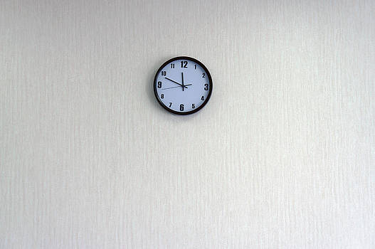 A Clock With A Blue Face On The Wall by Guang Ho Zhu