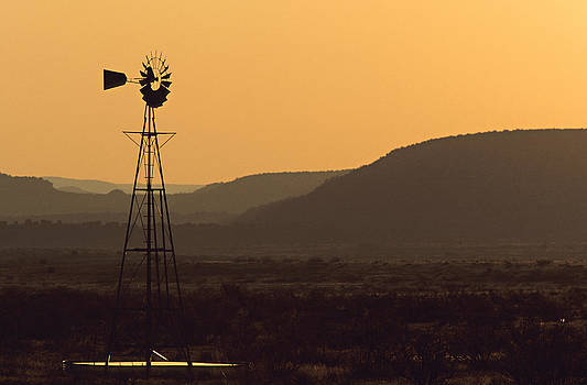 A Desert  Windmill At Sunset by Wesley Hitt