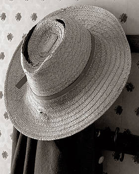 A farmers old straw hat by Dick Wood