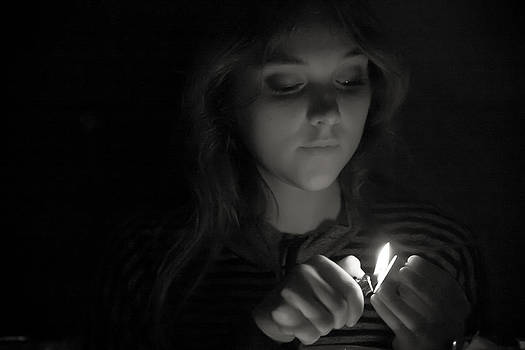 A girl with the lighter by Jacek Nazim
