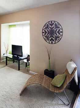 A Living Room With A Round Wrought Iron by Christian Scully