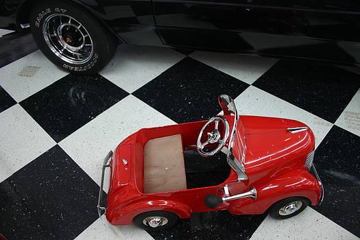 Nina Fosdick - a red pedal car