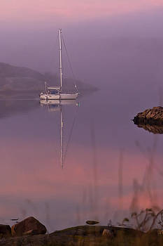 A sailboat in a misty sunset by Syssy Jaktman