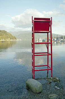 A Tall Empty Wooden Lifeguard Chair by Marlene Ford