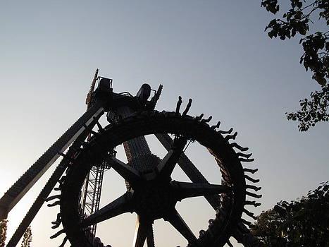 Alfred Ng - A Wheel of Many Feet