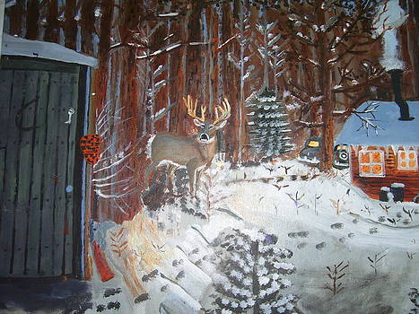 A whitetail buck in back of cabin in the snow by Swabby Soileau