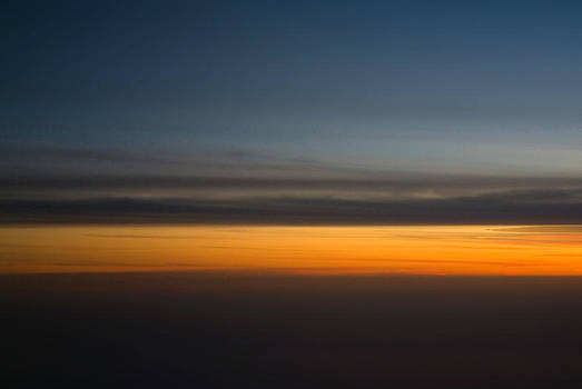 Abstract Sky through a plane window by Pixie Copley