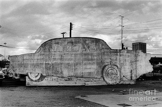 Advertising board for a car. Gallup New Mexico by Homer Sykes