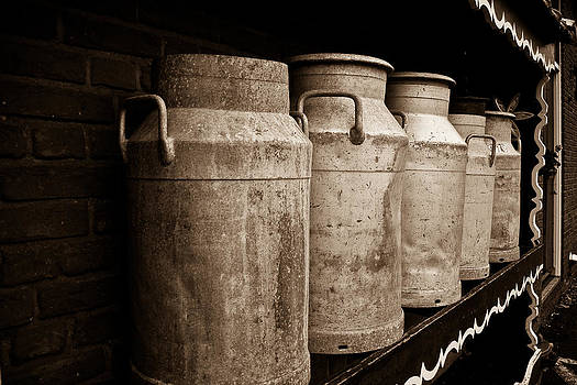 AMS-0031-Milk Canisters In Edam by Les Abeyta