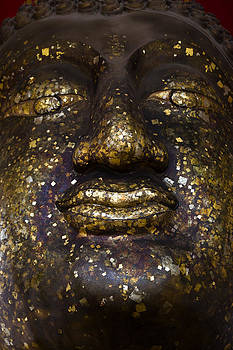 ancient Buddha face Ayutthaya Thailand  by Wasan Gredpree