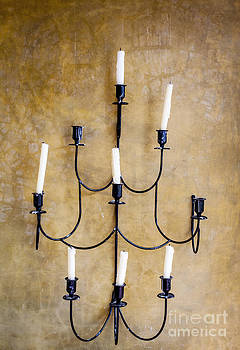 Ancient candelabra by Chavalit Kamolthamanon