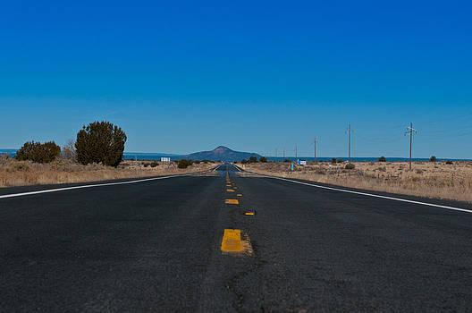 Arizona lonely road by Lucas Tatagiba