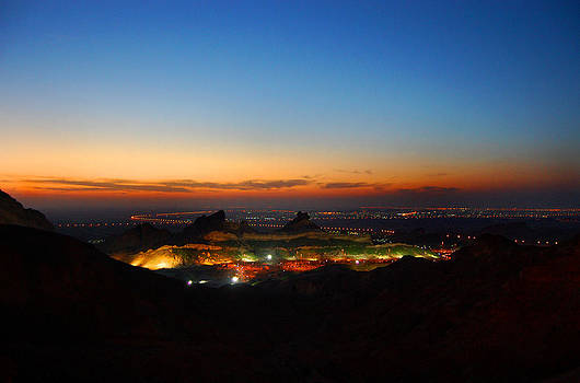 At the top by Farah Faizal