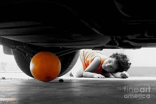 Ball under car . . by Mirash D