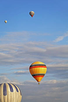 Kantilal Patel - Balloons drifting blue cloudy sky