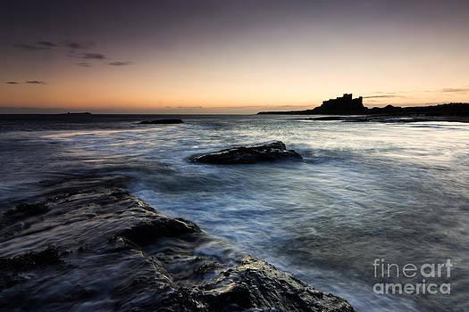 Bamburgh Castle Sunrise by David Smith