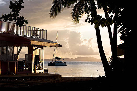 Beach house in the Caribbean at sunset. by Anya Brewley schultheiss