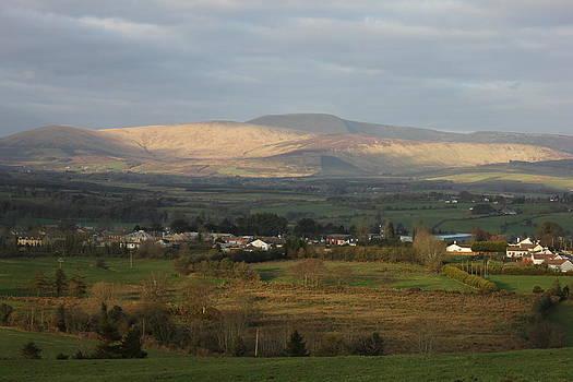 Joseph Doyle - Beautiful evening sun lights up the mountain landscape