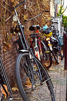 Bicycles On The Wall in Amsterdam by Les Abeyta