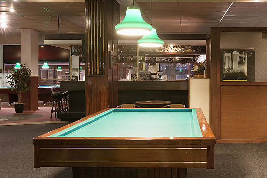 Billiards Table In Front Of A Bar by Corepics