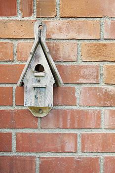 Birdhouse On Brick Wall by Bryan Mullennix
