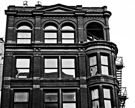 Black and White Brick Apartment Building by Alanna Pfeffer