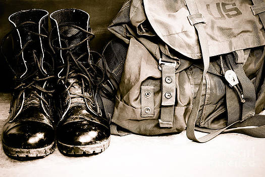 Black leather army boots and Army bag soldier by Pongsak Deethongngam