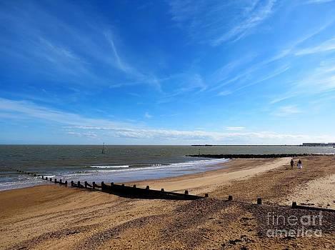 Blue Sky And A Beach - Walton On Naze by J J  Everson