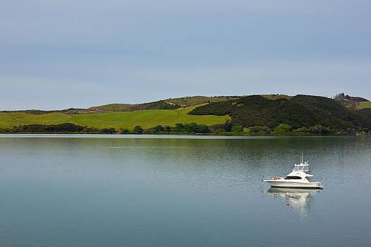 Boat on Still water by Mathew Tonkin Henwood
