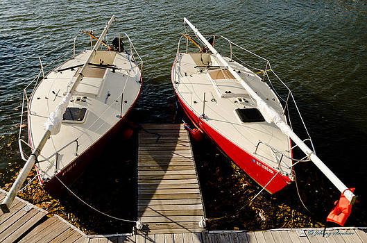 Boats docked by Johnny Sandaire
