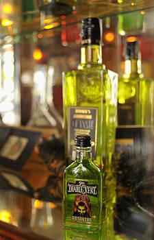 Bottles with Absinthe in Bar by Matthias Hauser