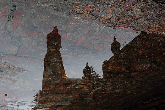 Buddha's shadow in the water. by Pitakpong Chansri