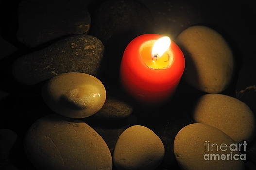 Sami Sarkis - Burning candle with pebbles in water