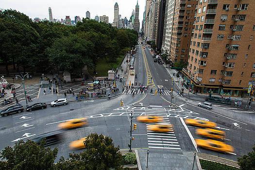 Cabs in Columbus Circle by John Dryzga