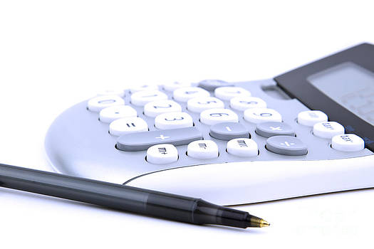 Calculator and pen by Blink Images