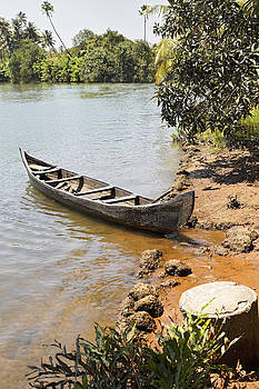 Kantilal Patel - Canoe moored on sandy bank